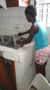 1. Chineca getting water for the drinking filter
