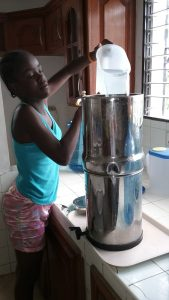 3. Chineca adding water to the drinking water filter
